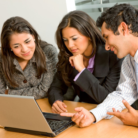 Team of workers on laptop